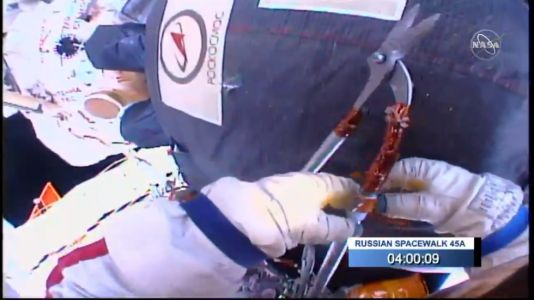 Russian cosmonauts spend nearly eight hours cutting into their spacecraft