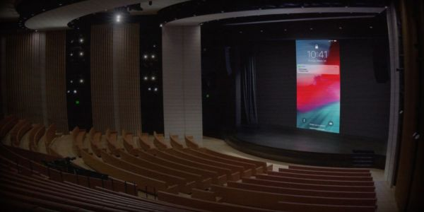Apple playfully turns on its March 25 event live stream early, showing an empty Steve Jobs Theater