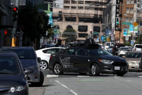 Uber lays off 100 safety drivers as it scales back self-driving tests