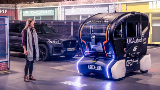 Jaguar Land Rover's self-driving pods beam their route onto the road