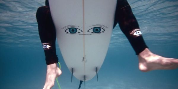 Surfers Are Sticking Eyes On Their Surfboards To Deter Sharks